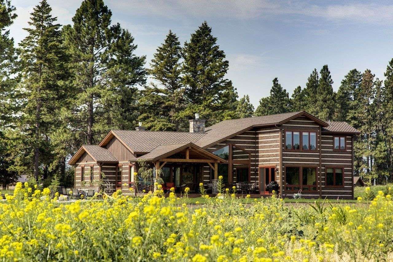 """This private residence located in Northwest, Montana features our 16"""" Hand-Hewn EverLog™ Concrete Log Siding in our popular Natural Brown color."""