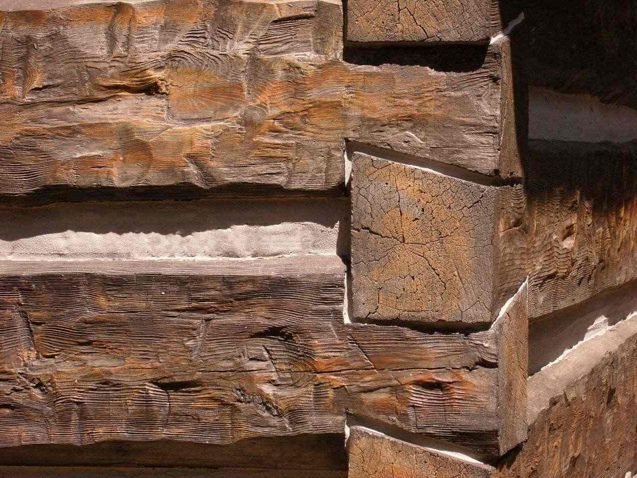 "16"" Hand-Hewn EverLogs with Dovetail Corners in Ponderosa color with chinking"