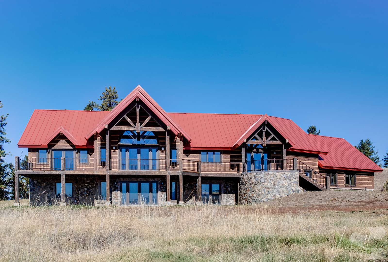 "16"" Hand-Hewn EverLog Siding in Natural Brown with Tahoe Gold Weatherall Chinking installed directly to Insulated Concrete Form (ICF) walls."