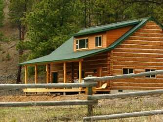 Traditional log home built with concrete hand-hewn logs.