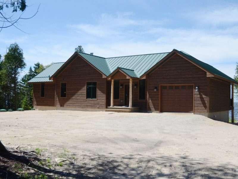 Garden, Michigan Lake Home With Concrete Log Siding