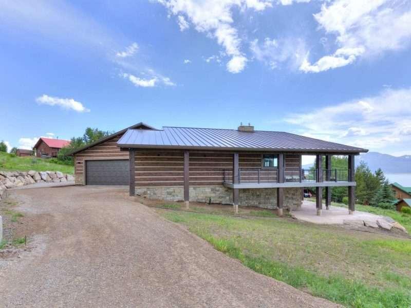 Modern Henry's Lake Idaho Concrete Hand-Hewn Log Home