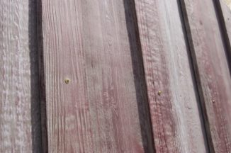 Weathered Barn Red Board and Batten Concrete Siding